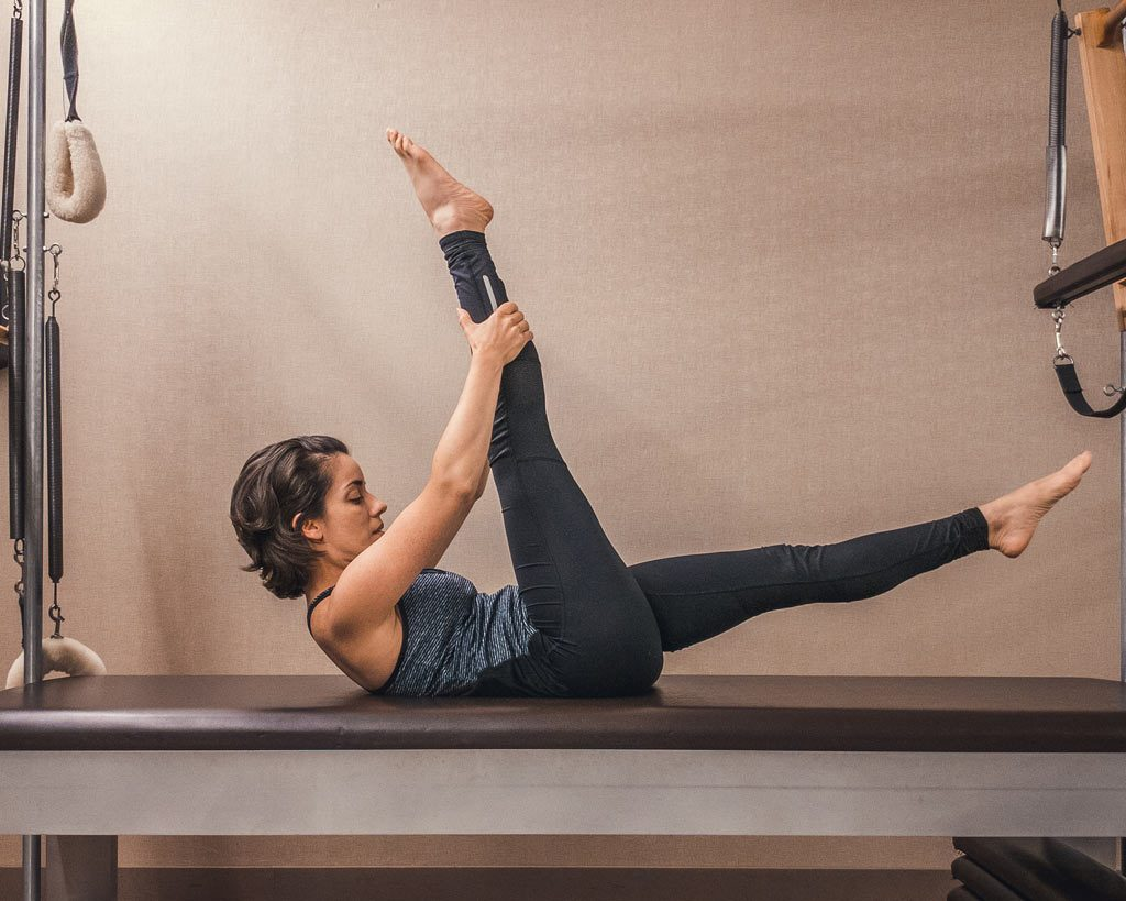 Core - Scissors - hug one leg straight upwards and the other let straight out at a diagonal